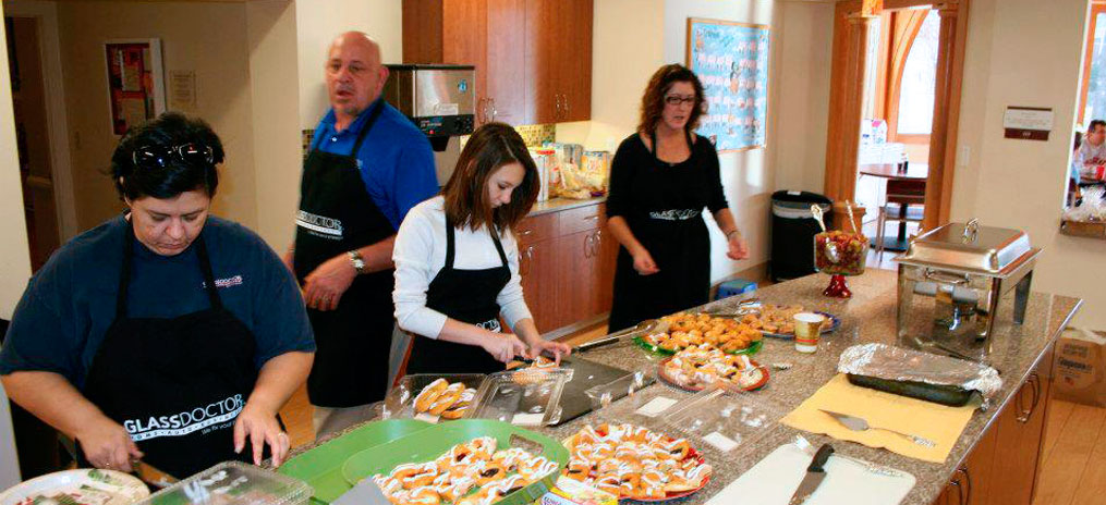 Glass Doctor Volunteers Serving Food At A Local Ronald McDonald House